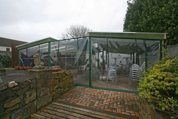 RB Sails recently manufactured and installed clear windproof screens for Pizza Patio's outside eating area in Hayle, Cornwall